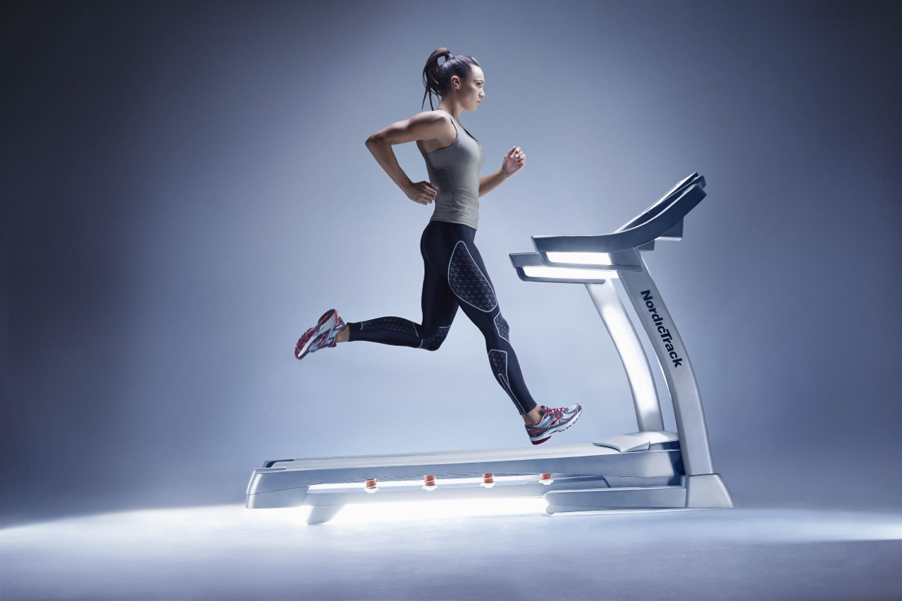 Fitness running machine getting fit with a
